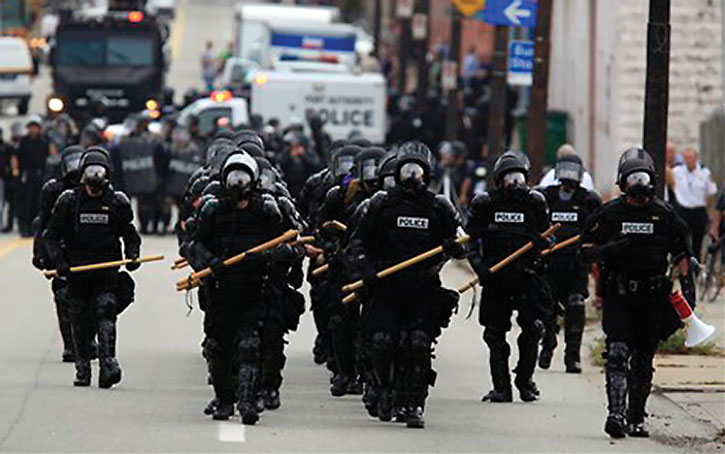 Stormtrooper-like riot police with batons
