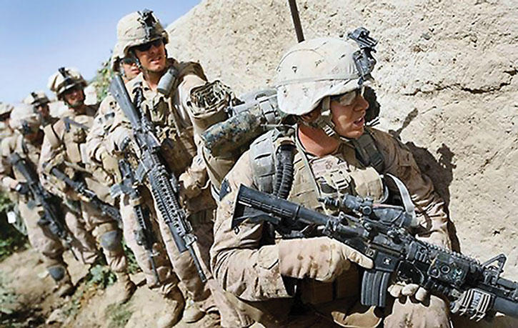US Marines with assault rifles and grenade launchers