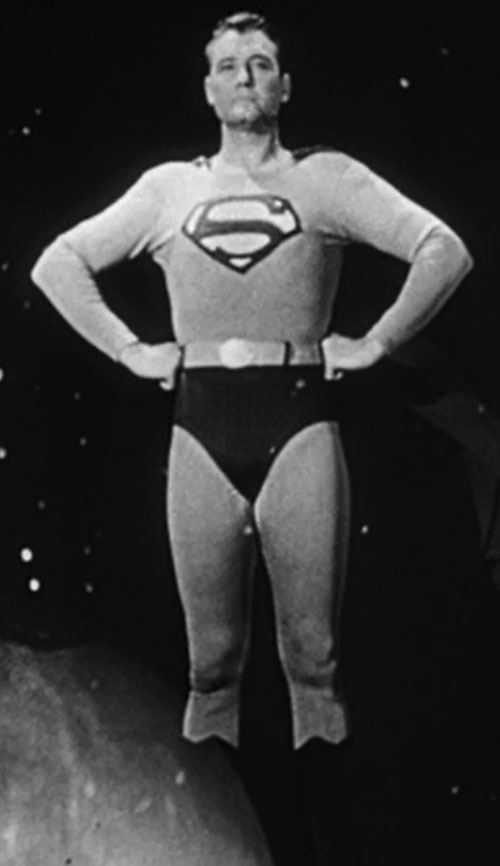 Superman (George Reeves in Adventures of Superman) posing with hands on hips