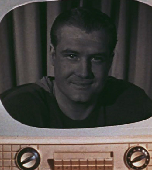 Superman (George Reeves in Adventures of Superman) - face on a vintage television