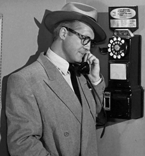 Superman (George Reeves in Adventures of Superman) using a public phone