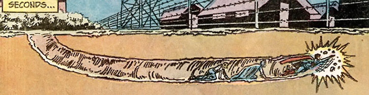 Superman Jr. tunnelling below a barbed wire fence