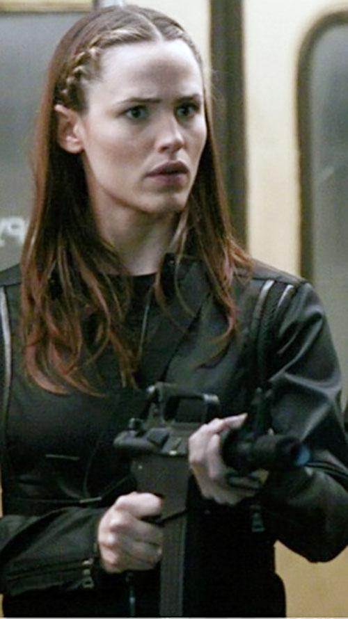 Sydney Bristow (Jennifer Garner in Alias) pointing an assault carbine