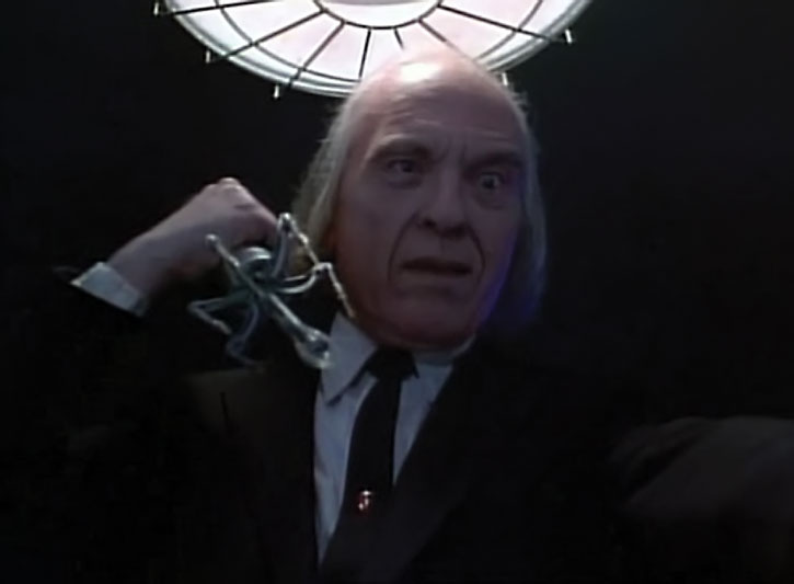 The Tall Man (Angus Scrimm) brandishing a strange instrument