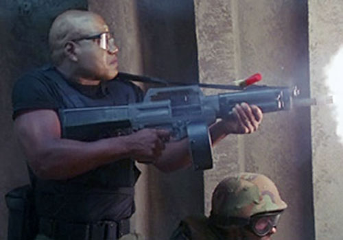 Teal'C (Christopher Judge in Stargate) firing an USAS shotgun