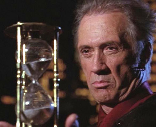 Tempus (Charmed demon) (David Carradine) - staring at his hourglass