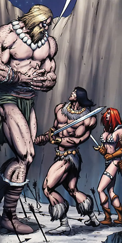 A giant faces Claw the Unconquered and Red Sonja