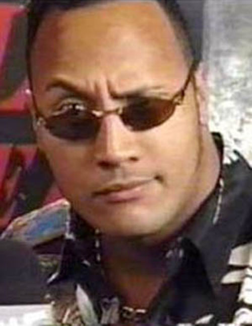 The Rock peering over his sunglasses
