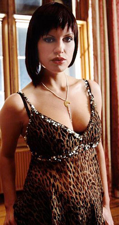 Thelma Bates (Jemina Rooper in Hex) in a jungle print dress