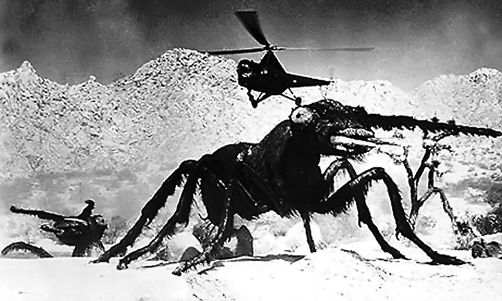 A 1950s helicopter flies over a gigantic radioactive ant