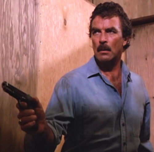 Thomas Magnum (Tom Selleck in Magnum PI) with blue shirt and .45 colt