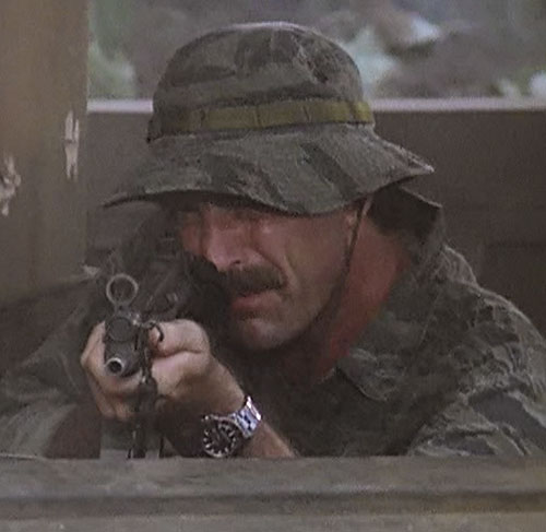 Thomas Magnum (Tom Selleck in Magnum PI) aiming a MP5 in uniform and boonie hat