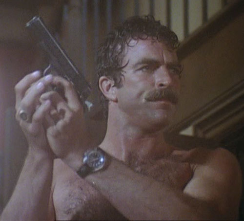 Thomas Magnum (Tom Selleck in Magnum PI) shirtless with his pistol