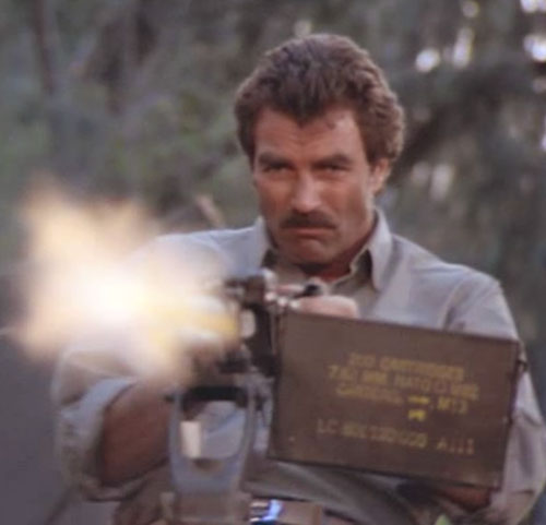 Thomas Magnum (Tom Selleck in Magnum PI) firing a machinegun