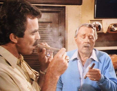 Thomas Magnum (Tom Selleck in Magnum PI) smoking a cigar