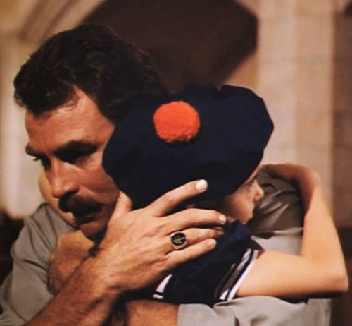 Thomas Magnum (Tom Selleck in Magnum PI) with a kid with a sailor hat