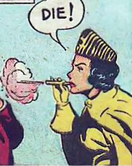 Tiger Woman (Madam Fatal enemy) (Quality Comics) using a small blowgun