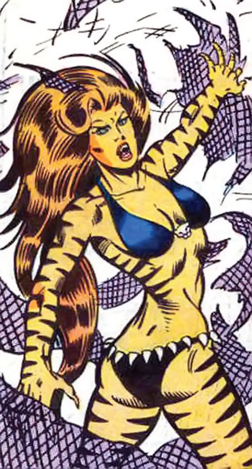 Tigra of the Avengers West Coast (Marvel Comics) tears a net apart