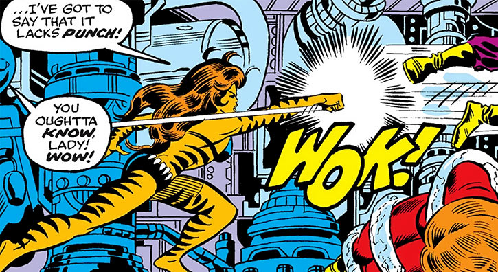 Tigra (Greer Nelson) throws a punch