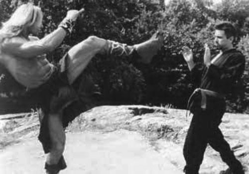 Matthias Hues in barbarian fur does a high kick