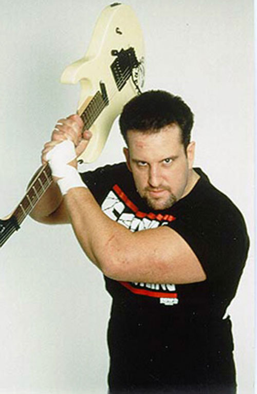 Tommy Dreamer brandishing a guitar