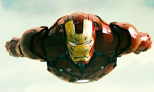 Iron Man (Robert Downey Jr. in the first Marvel movie) in flight with battle damaged armor