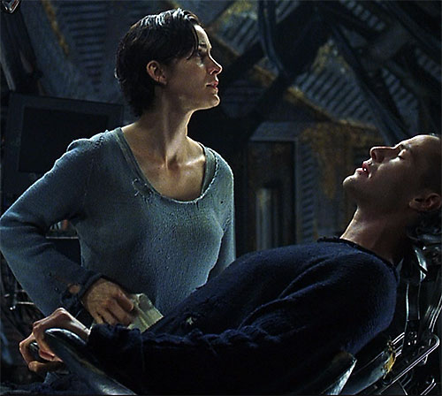 Trinity (Carrie-Anne Moss) with Neo in the Neb