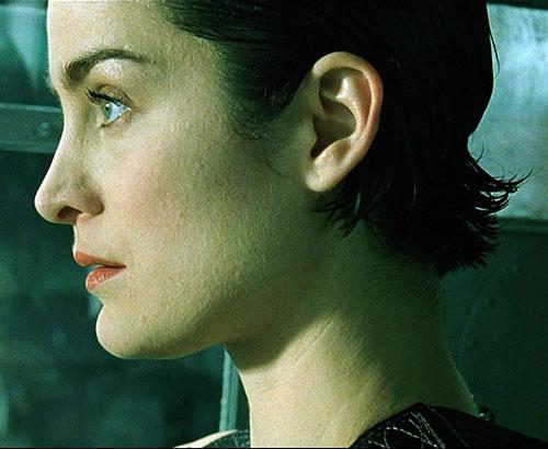 Trinity (Carrie-Anne Moss) side shot