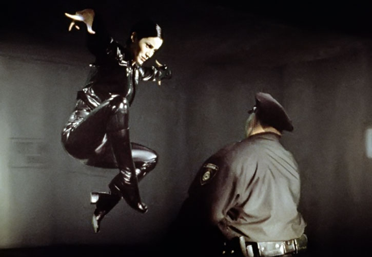 Trinity (Carrie-Anne Moss) floats before a kick