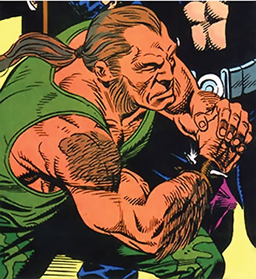 Trogg (Bane / Batman character) (DC Comics) in green fatigues and tank top