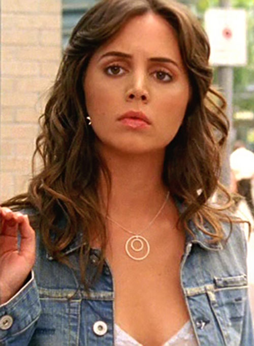 Tru Davies (Eliza Dushku) face closeup with denim vest