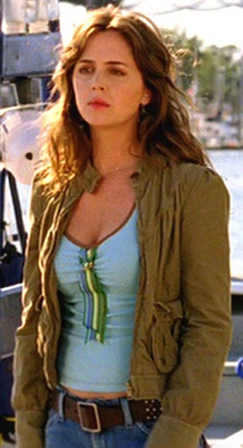 Tru Davies (Eliza Dushku) with an olive vest and light blue top