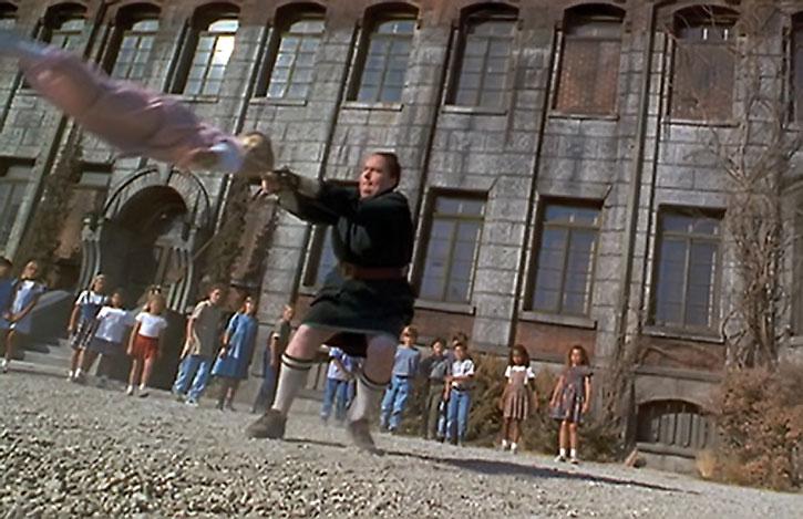 The Trunchbull (Pam Ferris) hurls a schoolgirl hammer-style