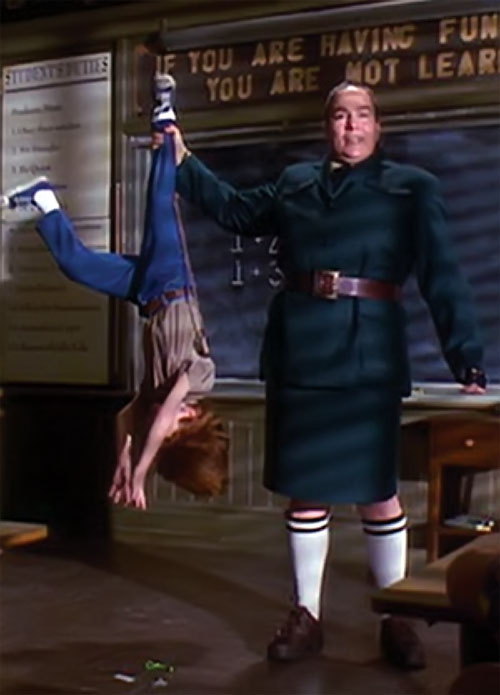 Trunchbull (Pam Ferris in Matilda) lifting a child by the ankle
