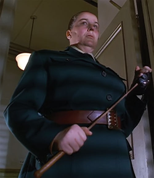 Trunchbull (Pam Ferris in Matilda) with a bottle green uniform