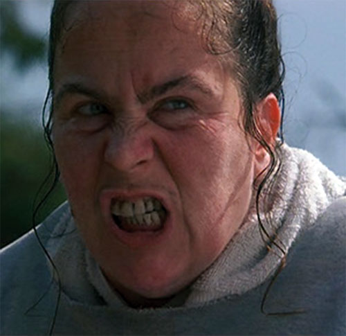 Trunchbull (Pam Ferris in Matilda) scowling with bad teeth