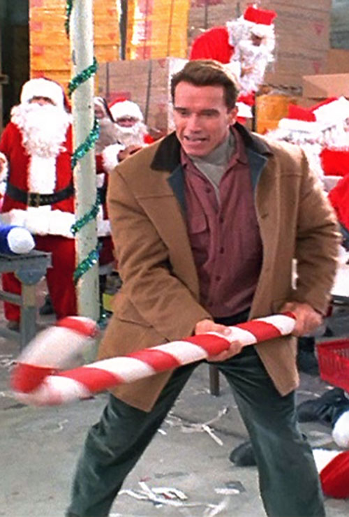 Turbo Man (Arnold Schwarzenegger in Jingle All The Way) with a giant candy cane