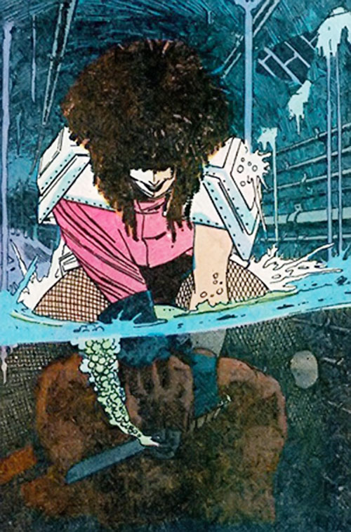 Typhoid (Daredevil character) (Marvel Comics by Nocenti) attempts to drown Daredevil and slit his throat