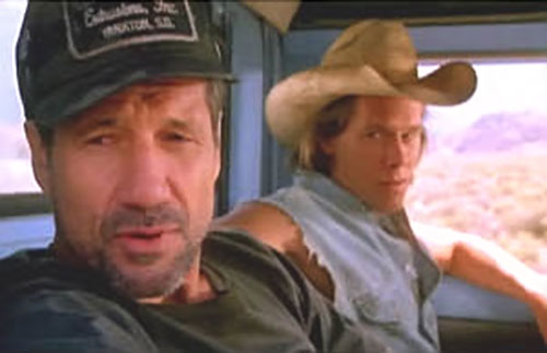 Valentine and Earl (Kevin Bacon and Fred Ward in Tremors movies) in a truck