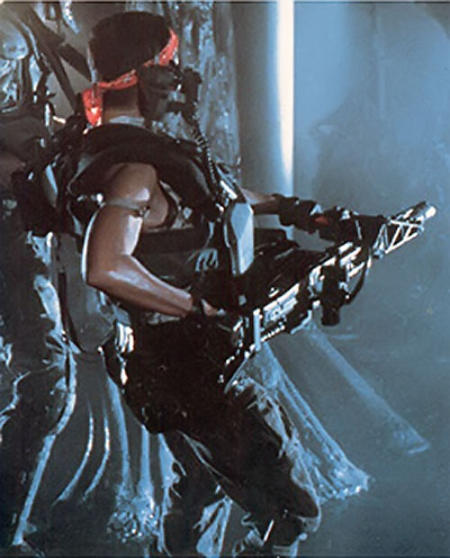 Vasquez (Jenette Goldstein in Aliens) with her smart gun
