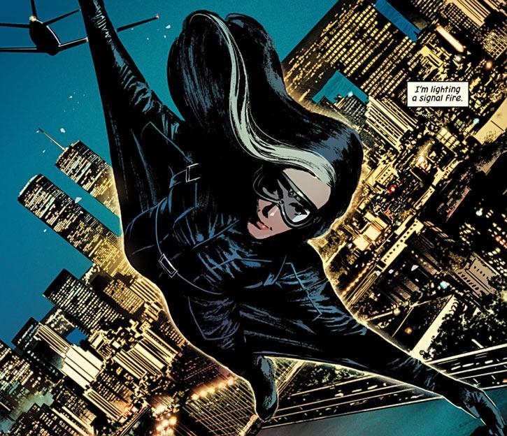 Velvet Templeton (Image Comics by Brubaker and Epting) gliding suit over New York