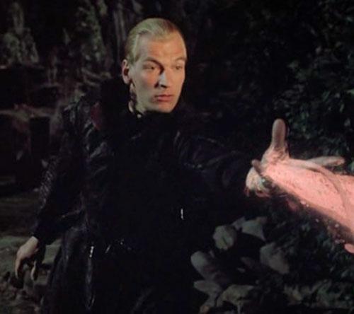 The Warlock (Julian Sands) casts a spell