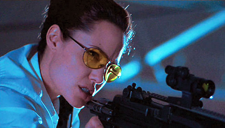 Angelina Jolie aiming a rifle