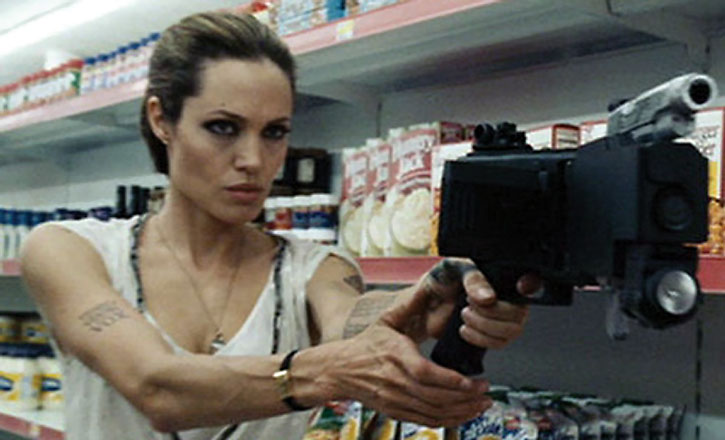 Angelina Jolie operating a cornershot device