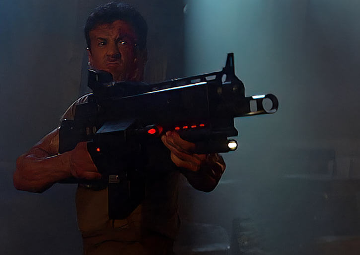 Sylvester Stallone with futuristic machinegun
