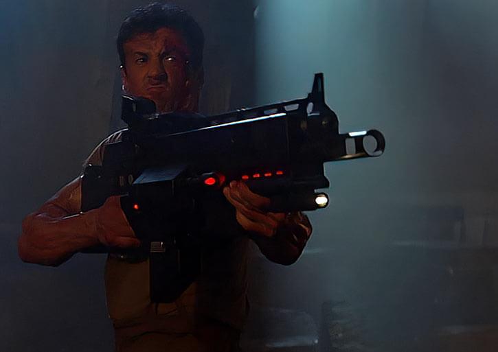 Sylvester Stallone with futuristic machinegun