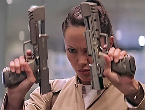 Angelina Jolie with 2 empty, locked back pistols