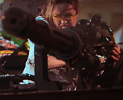Angelina Jolie operating a minigun