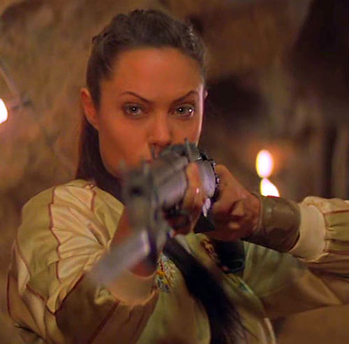 Angelina Jolie aiming a bayoneted older rifle