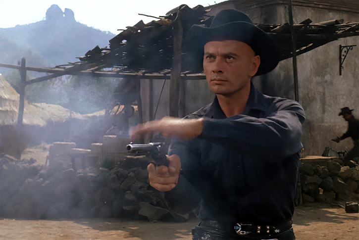 Yul Bryner fanning a Peacemaker in The Magnificent Seven